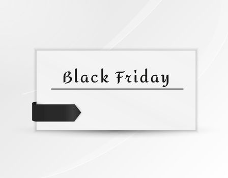 black friday paper with black ribbon on gray gradient background