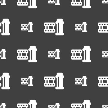 film Icon sign. Seamless pattern on a gray background. Vector illustration