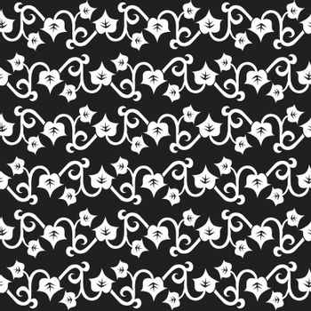 Seamless illustrated pattern made of white leaves on black background
