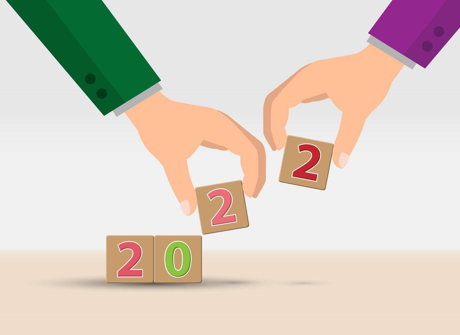 2022. The new year is 2022. The hand adds up the cubes with the new year 2022. Merry Christmas and Happy New Year by Grommik
